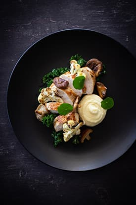 Roasted Chicken Breast, Parsnip Puree, Cauliflower, Shiitake & Kale