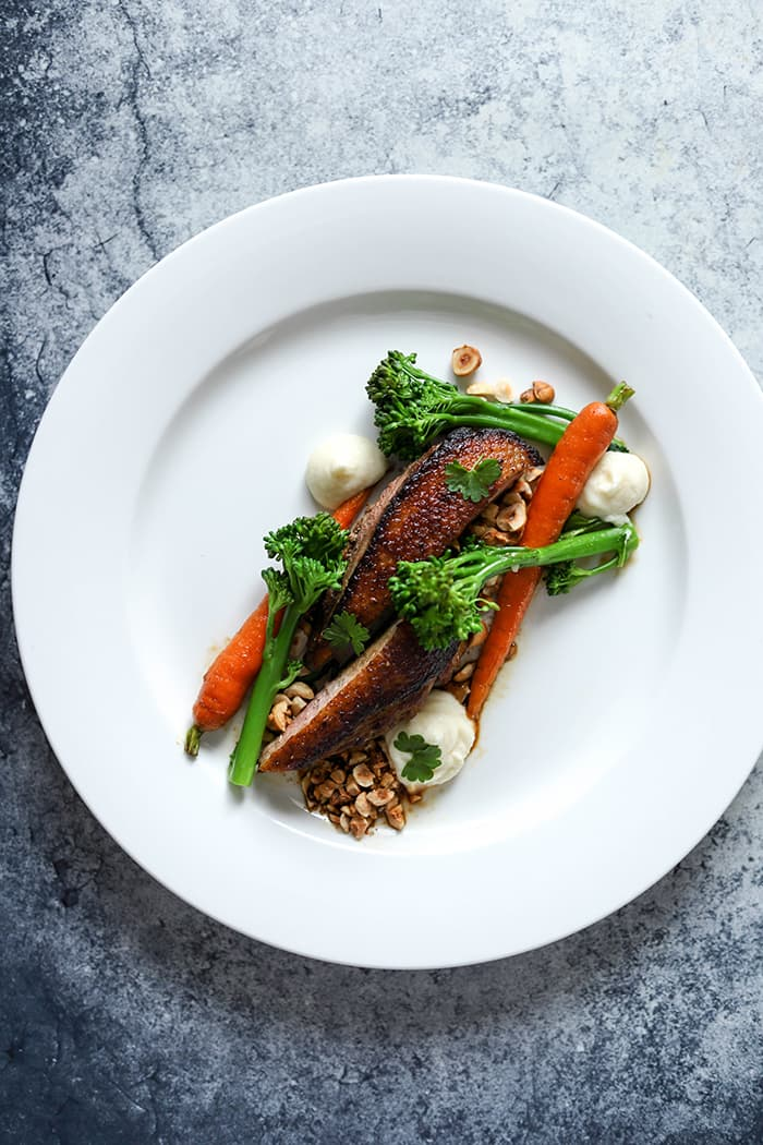 Orange & Honey Glazed Duck, Celeriac Puree, Spring Vegetables & Hazelnuts