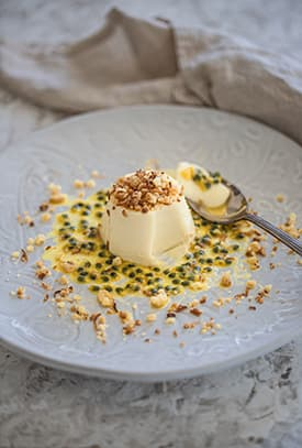 White Chocolate Panna Cotta, Passionfruit & Coconut Crumb